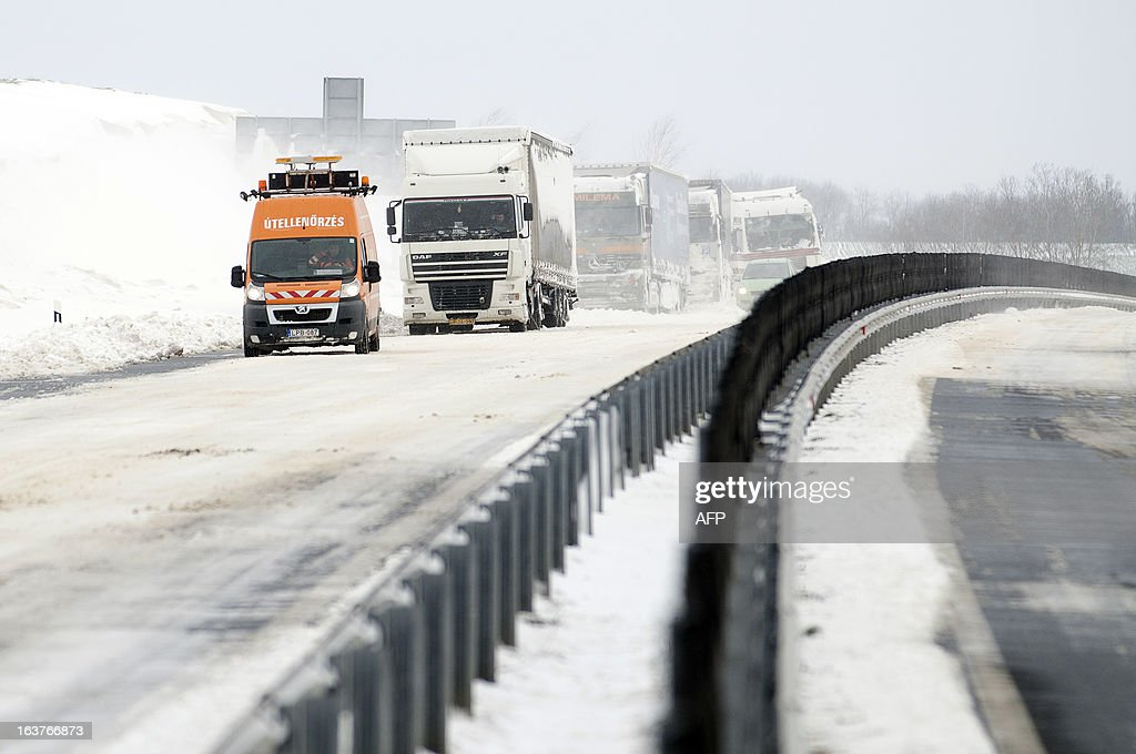 An emergency van checks out the situation at the site of an accident on the E71 motorway, nearby the Croatian, Slovenian and Hungarian borders on March 15, 2013 a day after a heavy snow storm hit the area. A cold snap that caused havoc elsewhere in Europe sent temperatures plunging and blanketed large parts of Hungary in snow, causing major transport problems and leaving tens of thousands without electricity.