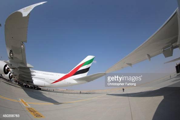 An Emirates A380 sits on the tarmac during the Dubai Airshow on November 18 2013 in Dubai United Arab Emirates The Dubai Air Show is the premier...