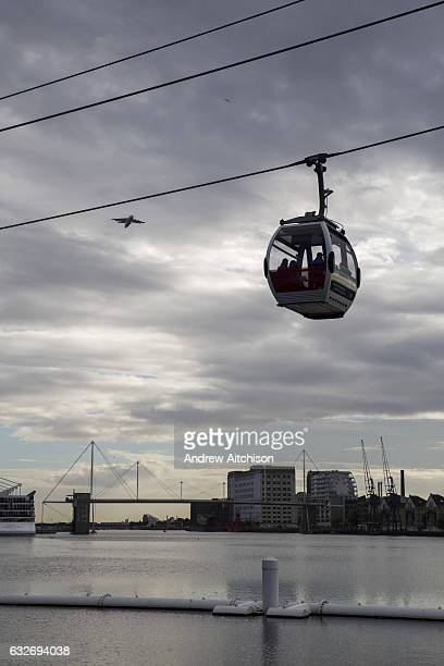 An Emirates Air Line Cable Car takes passengers across the River Thames between Greenwich Peninsula and the Royal Docks in London England United...