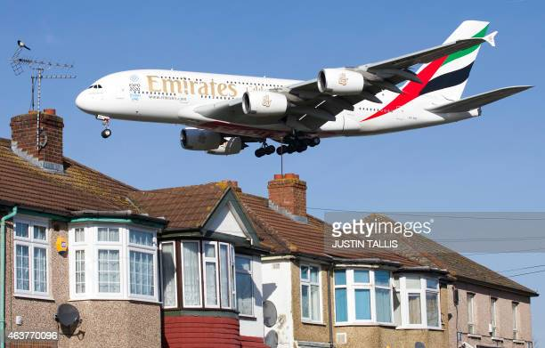 An Emirates Airbus A380 aircraft is seen above roof top as it comes into lane at Heathrow Airport in west London on February 18 2015 Heathrow's...