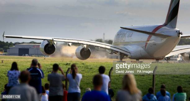 An Emirates Airbus A380 the world's largest airliner takes off from Birmingham International Airport to mark the extension of the airport's...