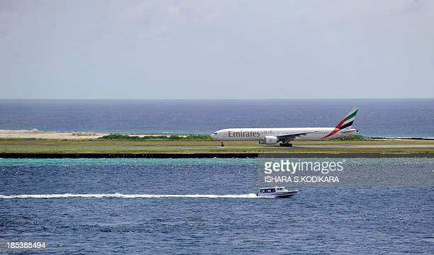 An Emirates airlines Airbus takes off from Male International Airport in Male on October 20 a day after police in the Maldives forced postponement of...