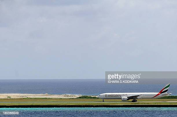 An Emirates airlines Airbus takes off from the Male International Airport in Male on October 20 a day after police in the Maldives forced...