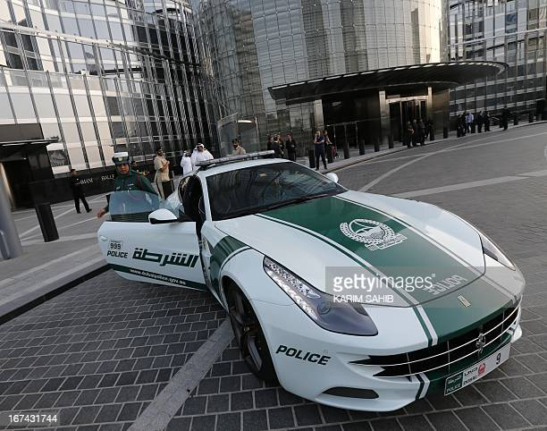 An Emirati female police officer gets out of a Lamborghini police vehicle on April 25 2013 in the Gulf emirate of Dubai Dubai police showed off a new...