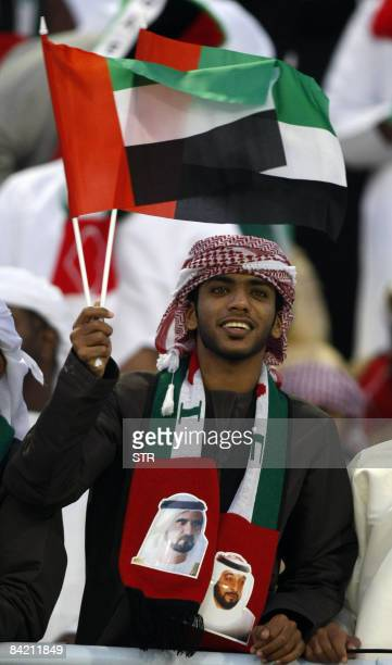 An Emirati football fan waves a national as he supports his team during a 19th Gulf Cup football match against Qatar in Muscat on January 8 2009 The...
