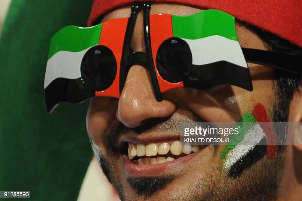 An Emirati football fan wears glasses with the national flag after his team's victory over Honduras in the Group F FIFA U20 World Cup football match...