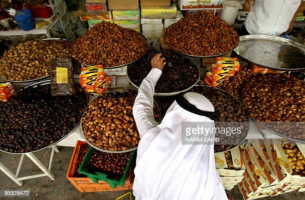 An Emirati man buys dates from a local market on August 31 2008 one day before the start of the holy month of Ramadan Muslims across the world are...