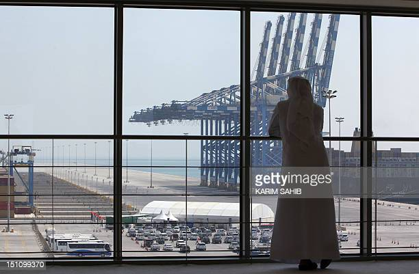 An Emirati man looks at a docking station in the new Khalifa Port in Abu Dhabi on September 1 2012 Oilrich Abu Dhabi began commercial operations at...