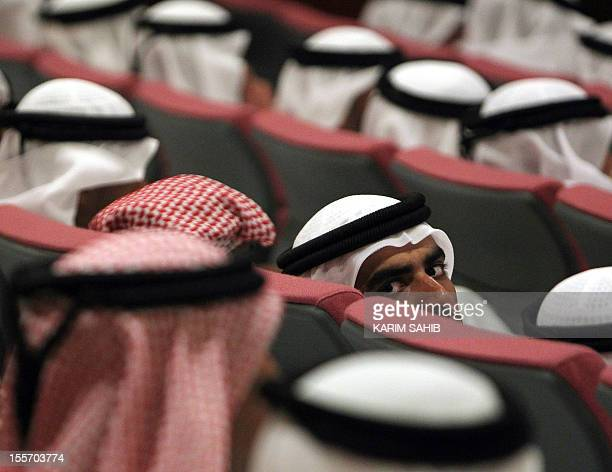 An Emirati man looks away while attending a conference oragnised by the Dubai police academy in the Gulf emirate on October 20 2010 AFP PHOTO/KARIM...