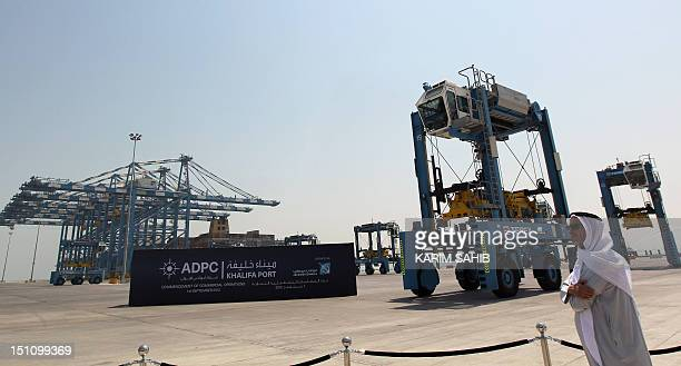 An Emirati man stands in the new Khalifa Port in Abu Dhabi on September 1 2012 Oilrich Abu Dhabi began commercial operations at its new Khalifa Port...