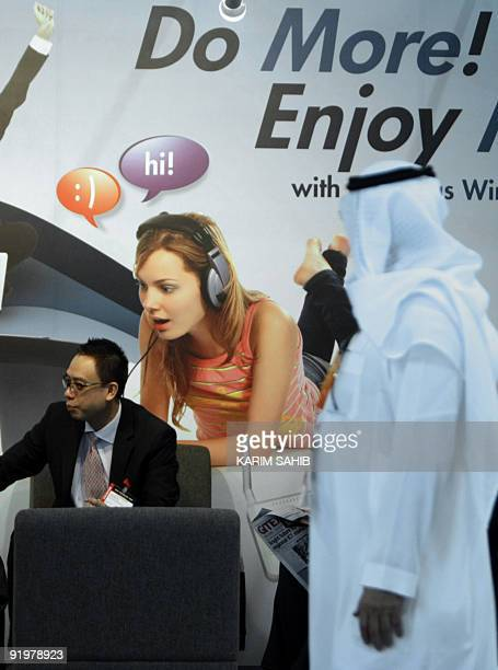 An Emirati man tours the annual GITEX information technology fair in Dubai on October 18 2009 The Middle East's largest information technology...