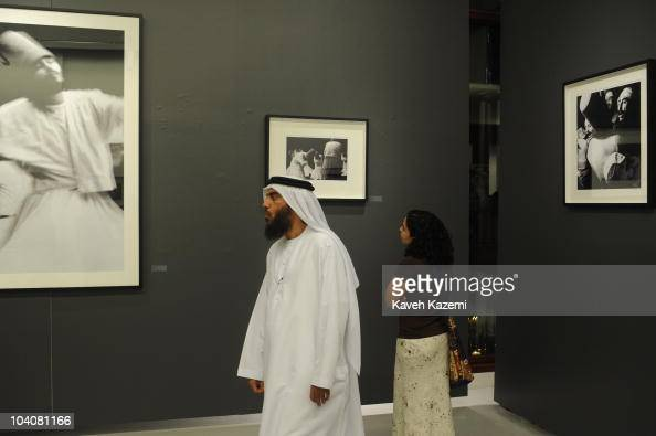 An Emirati man wearing traditional costume visits a photo exhibition during an arts evening held at galleries and public spaces in Dubai...