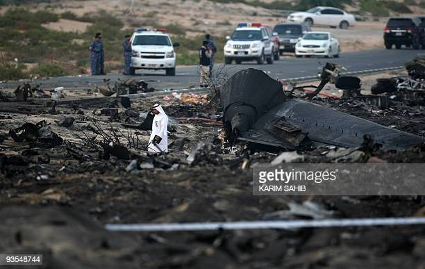 An Emirati official inspects the crash site of a Sudanese cargo plane in the Gulf emirate of Sharjah on October 21 2009 A Sudanese cargo plane...