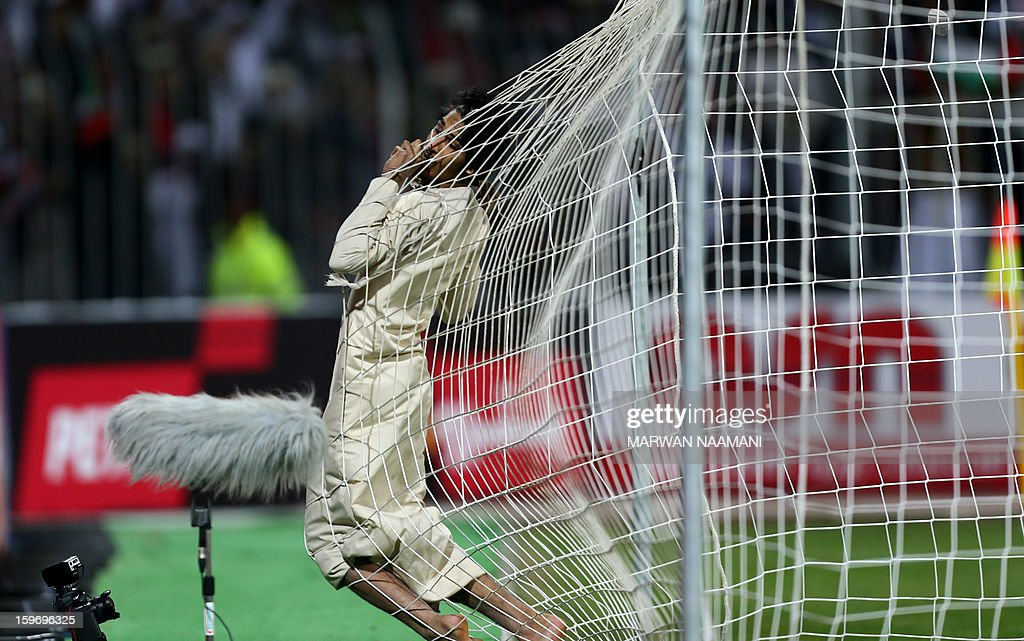An Emirati supporter enters the goal after running on the pitch during the 21st Gulf Cup's final between United Arab Emirates and Iraq on January 18, 2013 in Manama. United Arab Emirates won 2-1 against Iraq. AFP PHOTO/MARWAN NAAMANI