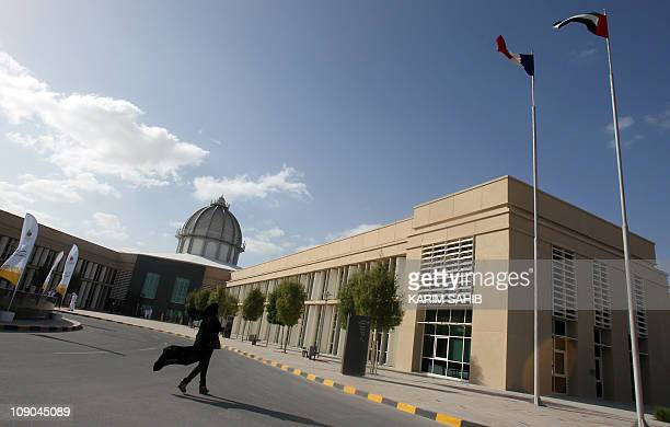 An Emirati woman walks at the new campus of the ParisSorbonne University Abu Dhabi in the Emirati capital on February 13 2011 Opened in 2006 Sorbonne...