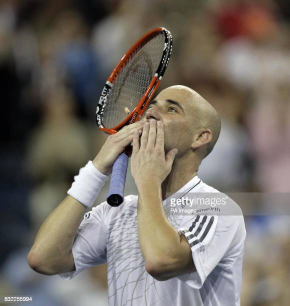 An emotional Andre Agassi celebrates after winning his first round match against Andrei Pavel during the US Open at Flushing Meadow New York After...