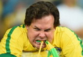 An emotional Brazil fan reacts after being defeated by Germany 71 during the 2014 FIFA World Cup Brazil Semi Final match between Brazil and Germany...