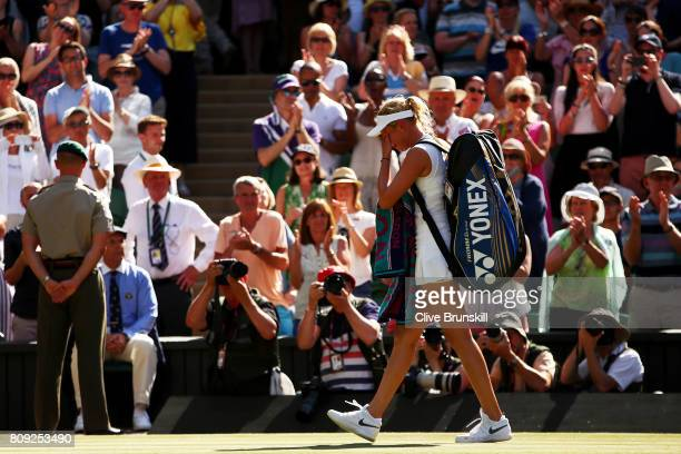 An emotional Donna Vekic of Croatia walks off court after defeat in the Ladies Singles second round match against Johanna Konta of Great Britain on...