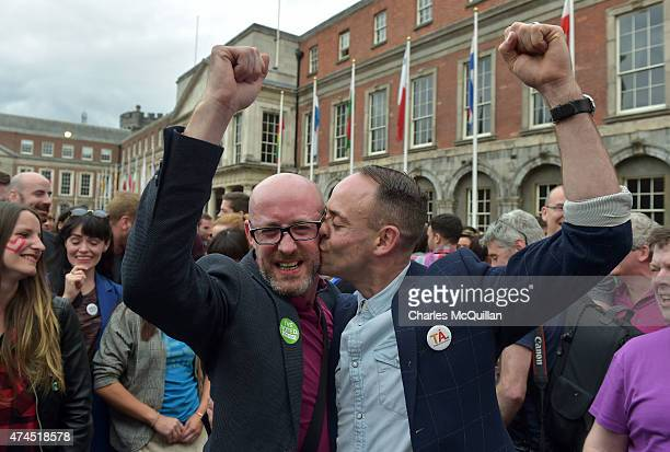 An emotional gay couple celebrate in Dublin Castle Square as the result of the referendum is relayed on May 23 2015 in Dublin Ireland Voters in the...