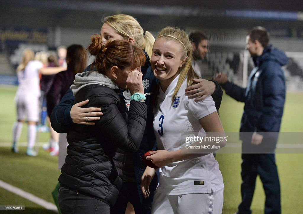 An emotional Leah Williamson (R) of England celebrates with her mother after a retaking last minute penalty after the UEFA U19 Women's Qualifier between England and Norway at Seaview on April 9, 2015 in Belfast, Northern Ireland. The original penalty, taken during the game played on Saturday April 4, 2015, was incorrectly disallowed by the match official and the retaking of the penalty, with both teams in attendance, was ordered by UEFA.