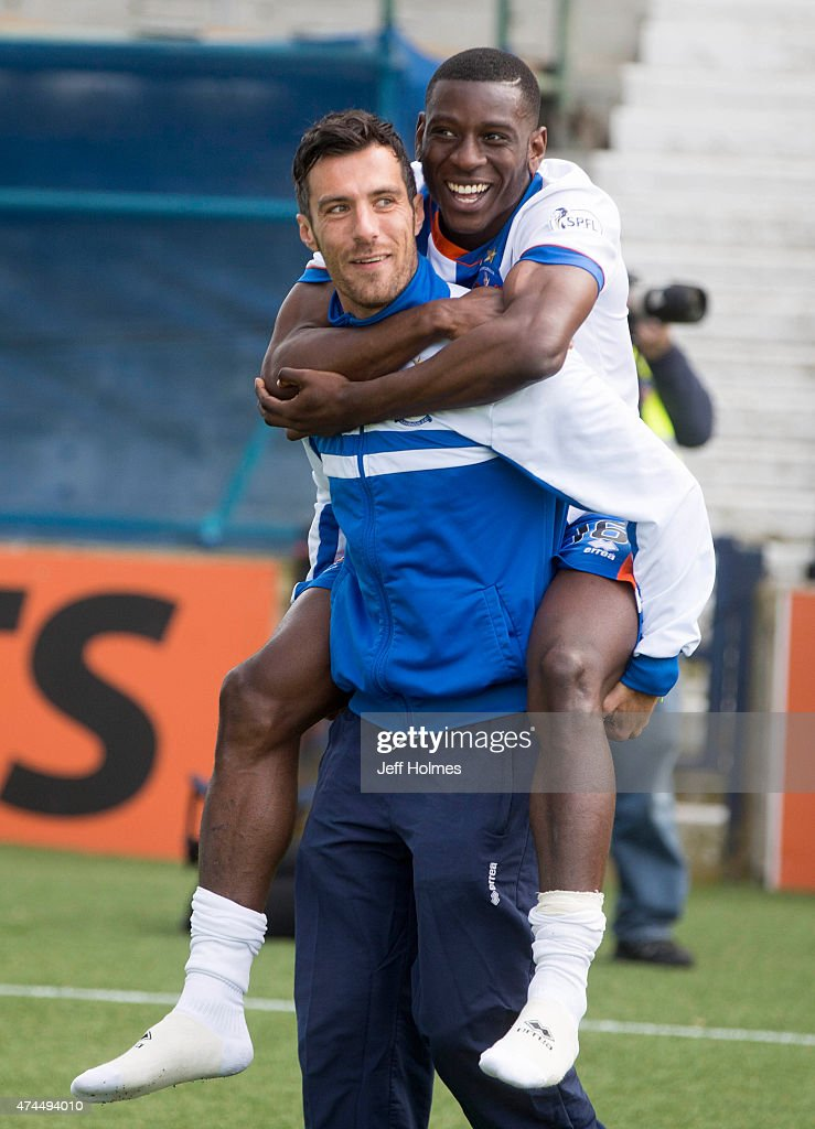 An emotional Manuel Pascali says goodbye for last time to Kilmarnock fans giving team mate Tope Obadeyi a lift round the park after the Scottish premiership match between Kilmarnock and Ross County at Rugby Park on May 23, 2015 in Kilmarnock, Scotland.