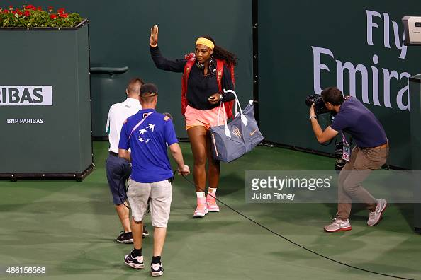 An emotional Serena Williams of USA arrives on court to play Monica Niculescu of Romania during day five of the BNP Paribas Open tennis at the Indian...