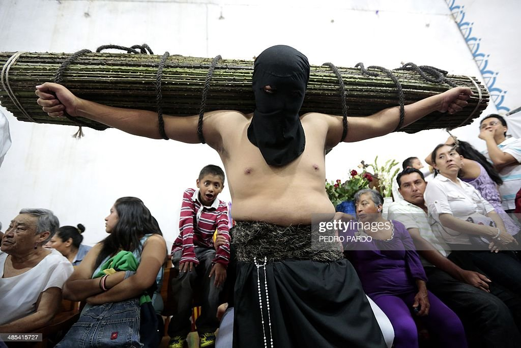 An 'empalao' penitent takes part in the Holy Thursday procession along a street of Taxco, Guerrero state, Mexico, on April 17, 2011. AFP PHOTO/Pedro PARDO