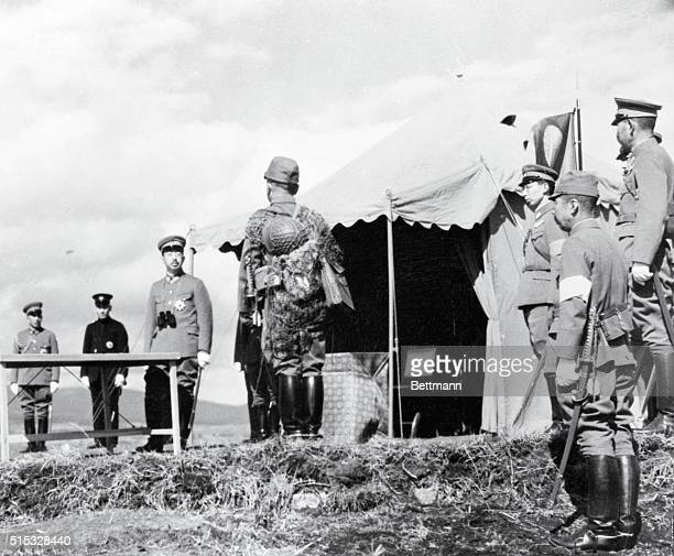 An Emperor Receives a Troop Report Numazu Japan His Majesty Emperor Hirohito of Japan listening attentively to a report being given him by Major...