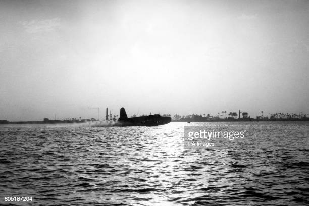 An Empire 'C' Class Flying Boat on the 'Horseshoe' route in from Durban tocuhing down on the Nile at RodelFarag near Cairo at sunset The Short...