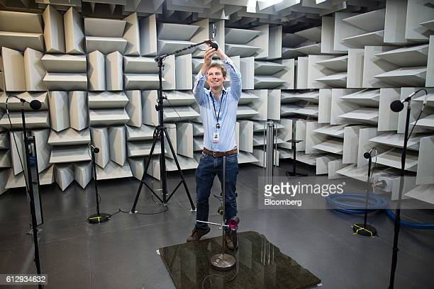 An employee adjusts a microphone as he prepares to test the acoustics of a Dyson Supersonic hair dryer inside the semianechoic chamber at the Dyson...