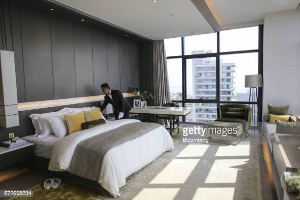 An employee adjusts bedding inside a show home at Lodha Altamount a luxury residential project developed by Lodha Developers Ltd in Mumbai India on...
