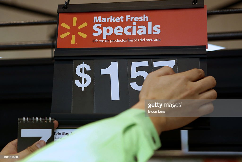 An employee adjusts the price on produce during the grand opening of a Wal-Mart Stores Inc. location in the Chinatown neighborhood of Los Angeles, California, U.S., on Thursday, Sept. 19, 2013. Wal-Mart Stores Inc. will phase out 10 chemicals it sells in favor of safer alternatives and disclose the chemicals contained in four product categories, the company announced Sept. 12. Photographer: Patrick T. Fallon/Bloomberg via Getty Images