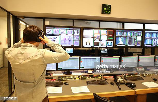 An employee adjusts their headphones as they stand in the control room inside commercial television studios operated by UTH Russia in Moscow Russia...