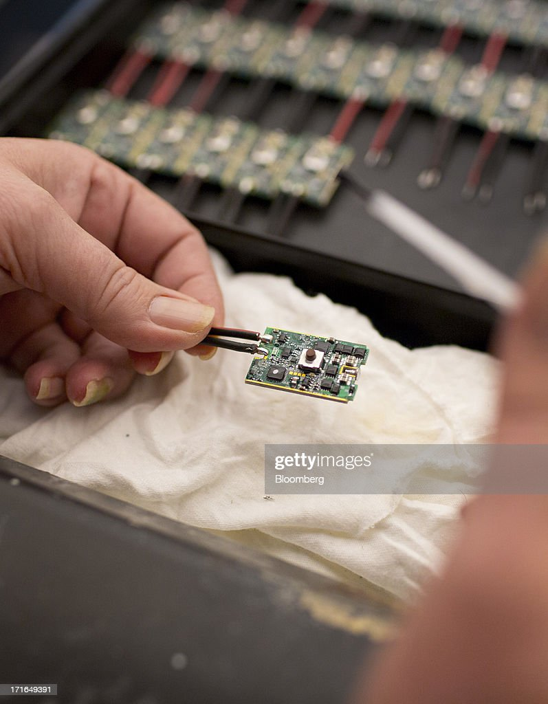 An employee applies a silicone coating to ProVari model electronic cigarette circuit boards at the ProVape Inc. facility in Monroe, Washington, U.S., on Wednesday, June 26, 2013. U.S. sales of electronic cigarettes are estimated to double in 2013 from last year, to $1 billion, according to estimates made by the Tobacco Merchants Association (TMA) and Mintel. Photographer: Mike Kane/Bloomberg via Getty Images