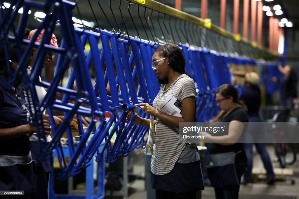 An employee applies decals to a Boys MT20 model bicycle frame at The Kent International Inc. Bicycle Corporation of America brand Assembly facility in Manning, South Carolina, U.S., on Sunday, June 25, 2017. Almost all of the roughly 18 million bicycles sold each year in the U.S. come from China and Taiwan. This year, about 130 workers at the Bicycle Corporation of America's new factory will assemble 350,000 bikes in the U.S. Photographer: Travis Dove/Bloomberg via Getty Images