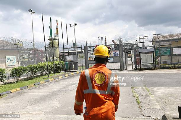 An employee approaches the entrance to the Agbada 2 oil flow station operated by Shell Petroleum Development Co in Port Harcourt Nigeria on Wednesday...