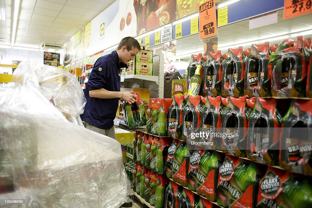 An employee arranges a display of beer for sale inside a Lidl discount supermarket store, operated by Schwarz Group, in Prague, Czech Republic, on Thursday, June 13, 2013. Ahold and Tesco are tied as the Czech Republic's third-largest grocer by revenue behind Lidl discount store owner Schwarz Group and Rewe AV, which owns the Billa supermarkets, according to Krakow, Poland-based market researcher PMR. Photographer: Martin Divisek/Bloomberg via Getty Images