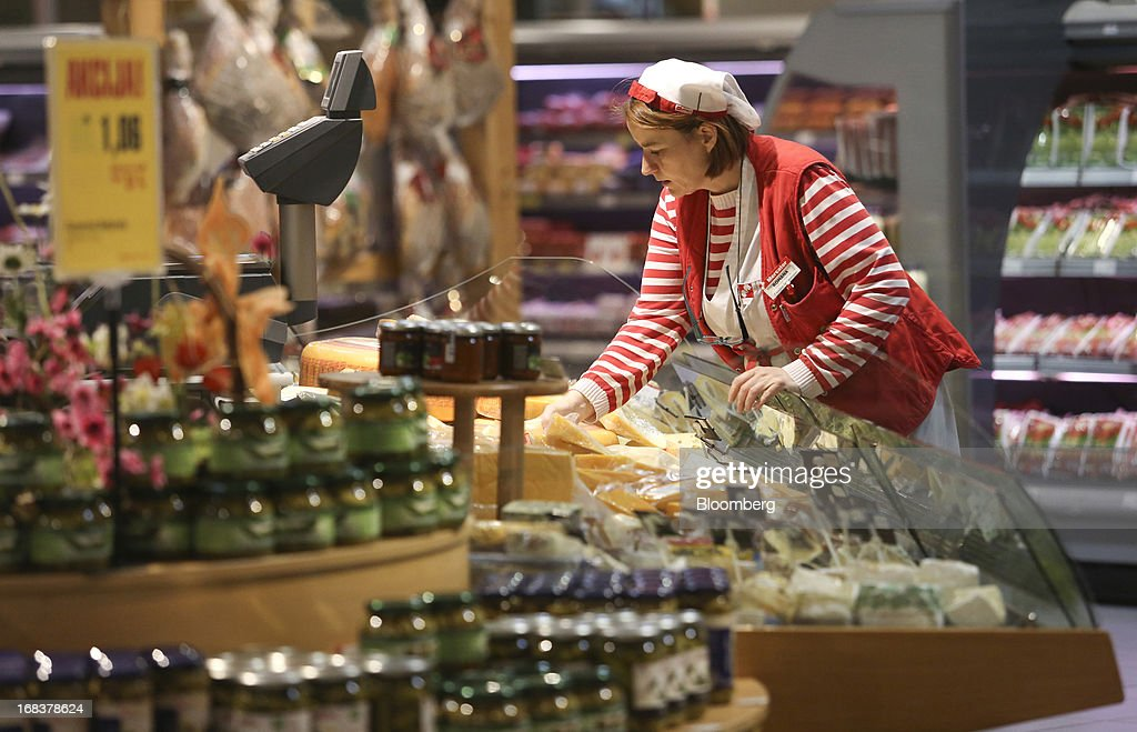 An employee arranges a display of cheeses in the delicatessen counter inside a Mercator Poslovni Sistem d.d. supermarket in Ljubljana, Slovenia, on Wednesday, May 8, 2013. In January Mercator reported its first full-year loss in fifteen years as the largest supermarket chain's sales in the Balkans last year suffered during the recession. Photographer: Chris Ratcliffe/Bloomberg via Getty Images