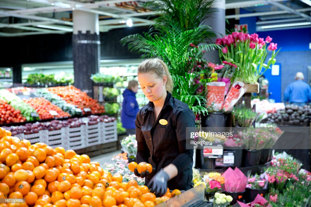 An employee arranges a display of fruit inside an ICA supermarket store in Stockholm, Sweden, on Tuesday, Feb. 19, 2013. Hakon Invest AB, the minority owner of Sweden's largest food retailer ICA, agreed to take full control by acquiring partner Royal Ahold NV's 60 percent stake for 20 billion kronor ($3.1 billion). Photographer: Casper Hedberg/Bloomberg via Getty Images