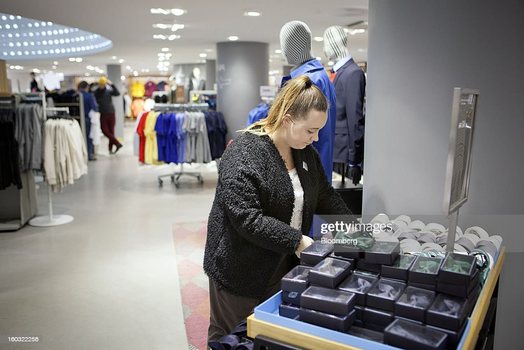 An employee arranges a display of men's accessories inside a Hennes & Mauritz AB (H&M) store in Stockholm, Sweden, on Tuesday, Jan. 29, 2013. Hennes & Mauritz AB, Europe's second-largest clothing retailer, reported sales growth that beat analysts' estimates for a second consecutive month as the chain offered markdowns in advance of the Christmas holiday. Photographer: Casper Hedberg/Bloomberg via Getty Images