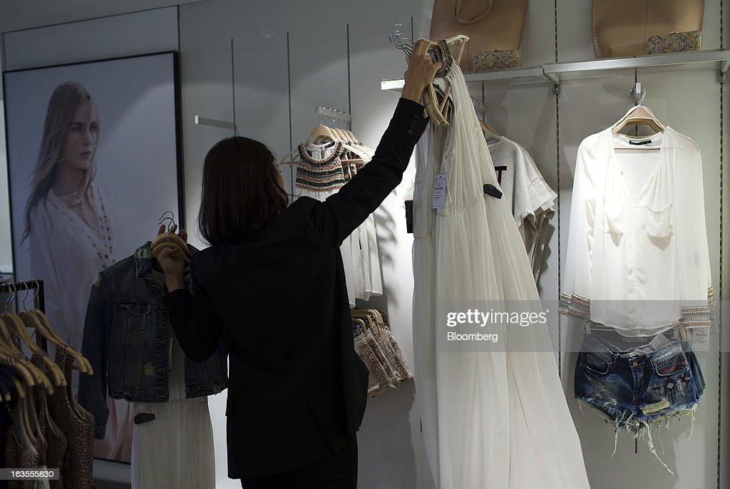 An employee arranges a display of women's clothes inside a Zara fashion store, operated by Inditex SA, in Madrid, Spain, on Tuesday, March 12, 2013. Europe's richest man, Amancio Ortega, the 76-year-old founder of Inditex SA, the world's biggest clothing retailer and owner of the Zara clothing chain, is No. 3 on Standard & Poor's 500 Index with a net worth of $57.4 billion, $4.9 billion ahead of Warren Buffett, 82. Photographer: Angel Navarrete/Bloomberg via Getty Images