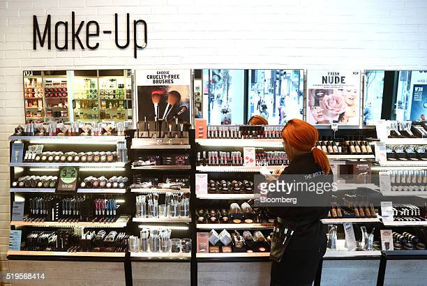 An employee arranges and counts cosmetics on display inside a Body Shop International Plc store owned by L'Oreal SA in London UK on Thursday April 6...