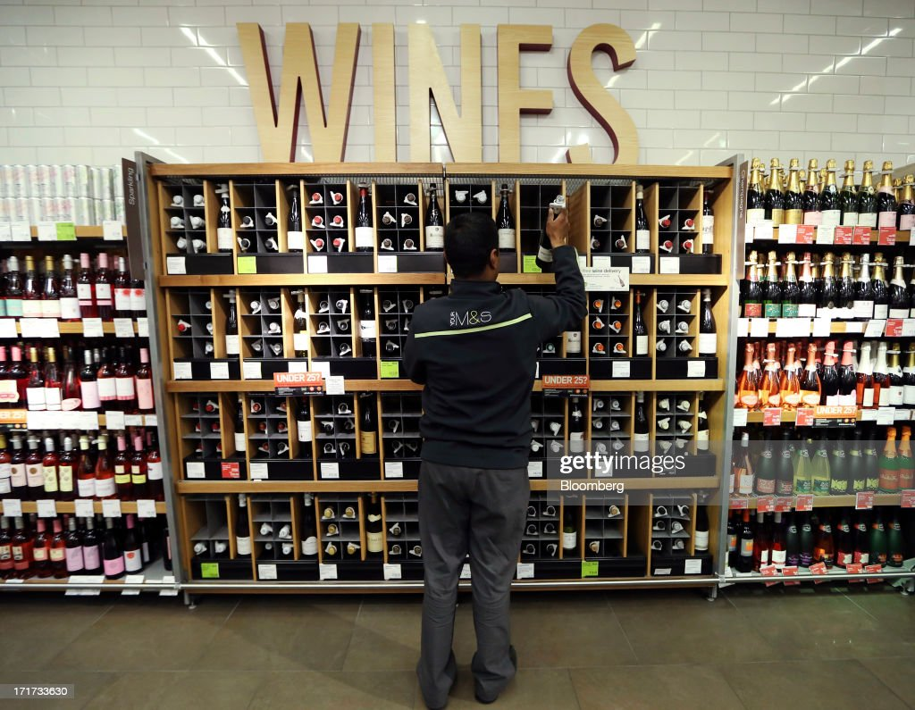 An employee arranges bottles of wine inside a Marks & Spencer Group Plc (M&S) food hall in the Westfield Stratford City retail complex in London, U.K., on Thursday, June 27, 2013. U.K. retail sales rose more than economists forecast in May as consumers spent more online and food sales increased at their fastest pace for more than two years. Photographer: Chris Ratcliffe/Bloomberg via Getty Images