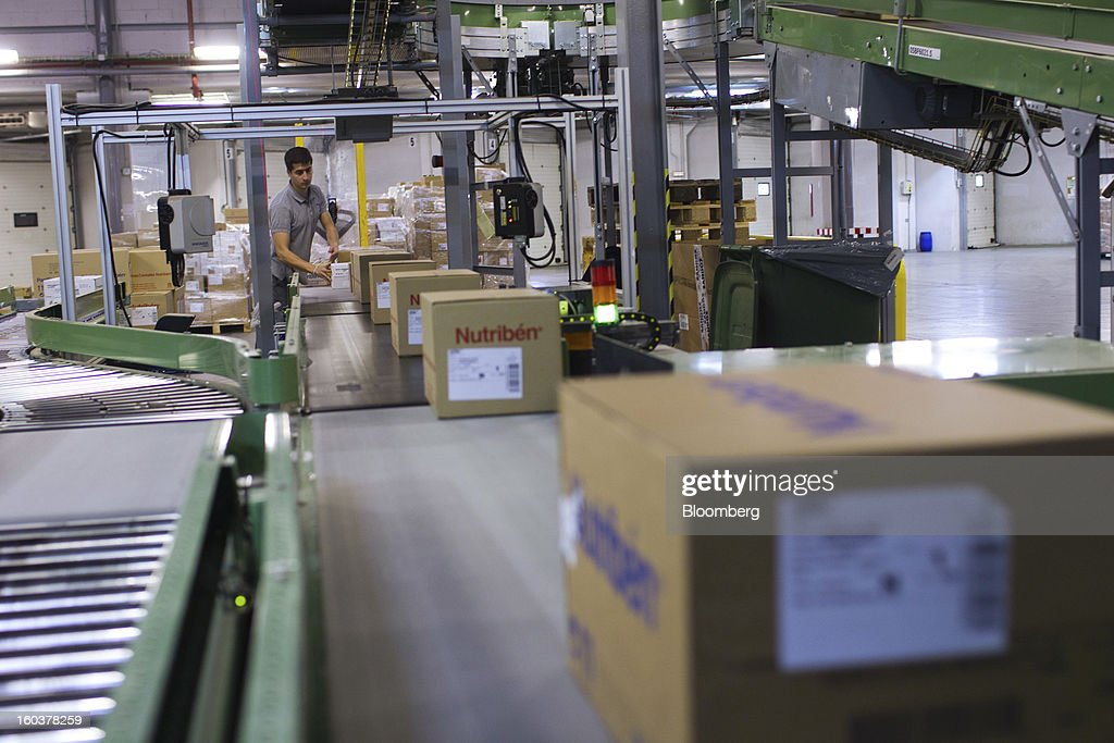 An employee arranges boxes of Nutriben infant food supplement for distribution to customers at the Cofares SA logistical plant in Guadalajara, Spain, on Wednesday, Jan. 30, 2013. Madrid, the second-biggest contributor to Spain's economy after Catalonia, has sliced 1 billion euros from its budget in 2012, increasing public-transportation costs and university fees, cutting jobs, delaying investments and reducing health-care and social benefits. Photographer: Angel Navarrete/Bloomberg via Getty Images
