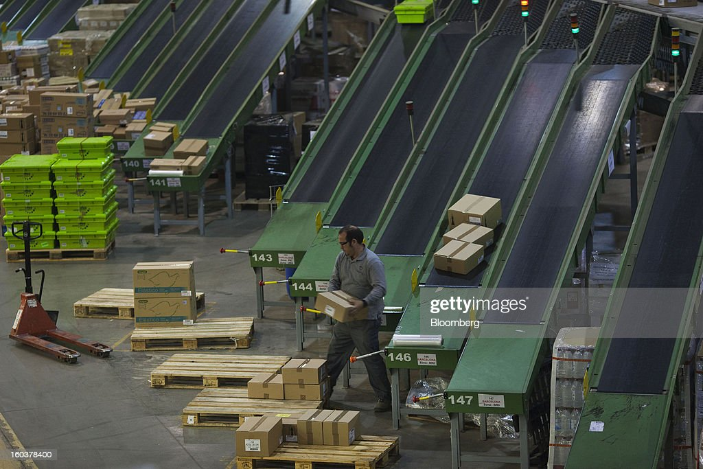 An employee arranges boxes of pharmaceutical products on pallets for distribution to customers at the Cofares SA logistical plant in Guadalajara, Spain, on Wednesday, Jan. 30, 2013. Madrid, the second-biggest contributor to Spain's economy after Catalonia, has sliced 1 billion euros from its budget in 2012, increasing public-transportation costs and university fees, cutting jobs, delaying investments and reducing health-care and social benefits. Photographer: Angel Navarrete/Bloomberg via Getty Images