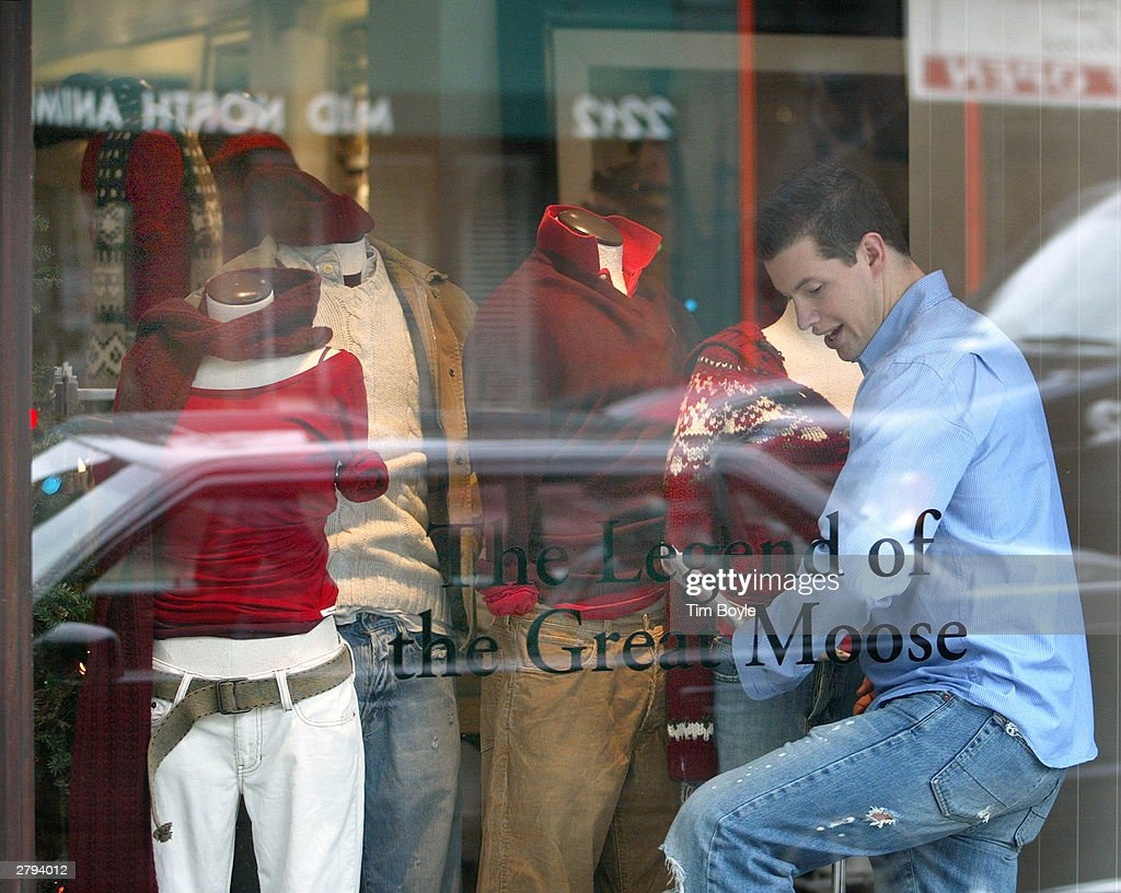 An employee arranges clothing on mannequins in a window display at an Abercrombie & Fitch clothing store December 8, 2003 in Chicago, Illinois. A recent report claims that Abercrombie & Fitch discriminates against sales representatives based on their 'attractiveness.' They have also decided to remove its Christmas catalog, which some claim featured sexually explicit images, from its store shelves.