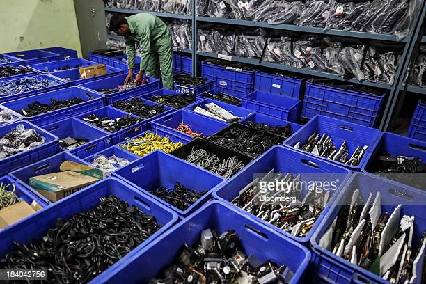 An employee arranges computer accessories at the Attero Recycling Pvt facility in the Raipur Industrial area of Bhagwanpur in Roorkee Uttarkhand...