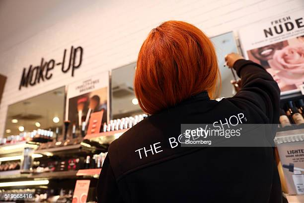 An employee arranges cosmetics on display inside a Body Shop International Plc store owned by L'Oreal SA in London UK on Thursday April 6 2016 The...