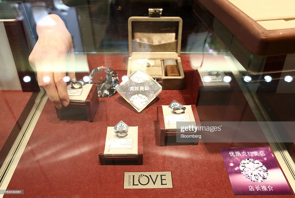 An employee arranges diamond rings at the Chow Sang Sang Holdings International Ltd. jewelry store in the Sanlitun district of Beijing, China, on Monday, March 11, 2013. China's consumer prices climbed 3.2 percent from a year earlier, according to figures released March 9, exceeding January's 2 percent gain and the median estimate for a 3 percent increase in a Bloomberg survey of analysts. Photographer: Tomohiro Ohsumi/Bloomberg via Getty Images