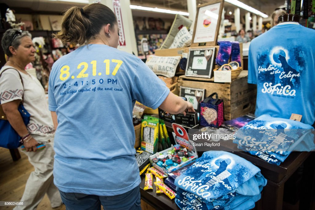 An employee arranges eclipse merchandise at Mast General Store August 20, 2017 in Columbia, South Carolina. Columbia is one of the prime destinations for viewing Monday's solar eclipse and NASA expects clear weather to bring over a million visitors to the state.